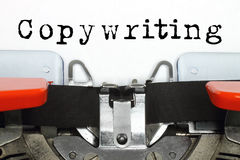 Peça da máquina de datilografia com palavra copywriting datilografada Fotografia de Stock Royalty Free