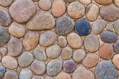 Peça de uma parede de pedra, para o fundo ou a textura Fotografia de Stock