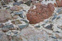 Peça de uma parede de pedra antiga imagens de stock