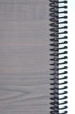 Peça do caderno em um fundo de madeira Foto de Stock