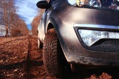 Peça do carro na estrada do outono Imagem de Stock