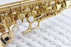 Peça do saxofone e da nota Imagem de Stock Royalty Free