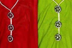 Peças do vestido fêmea com a foto à moda do fundo do botão Imagem de Stock