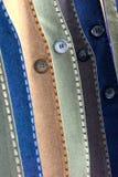 Peças dos ternos com a foto do fundo dos botões Fotografia de Stock