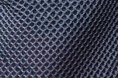 Peças pretas da malha da textura do fundo do sportswear fotografia de stock royalty free