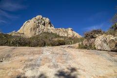 PEÑA DE BERNAL- is a monolith in the Queretaro state of Mexico. PEÃ'A DE BERNAL- is a monolith in the Queretaro state of Mexico, travel, rock stock photo