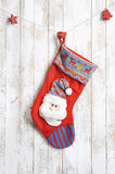 Peúga do Natal no fundo de madeira Imagens de Stock Royalty Free