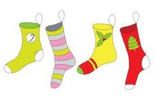 Peúgas coloridas do Natal Imagens de Stock Royalty Free