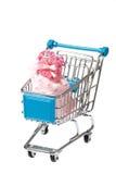 Peúgas cor-de-rosa do bebê no trole Fotos de Stock