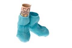 Peúgas das crianças e euro- notas de banco Fotografia de Stock Royalty Free