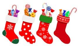 Peúgas do Natal com doces Fotografia de Stock