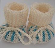 Peúgas feitas malha do bebê Fotografia de Stock