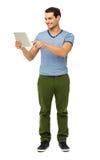 Pełna długość Dotyka Cyfrowej pastylkę mężczyzna Obrazy Royalty Free