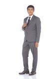 Pełna długości kłapnięcia postać, Biznesowego mężczyzna stojak w szarość Nadaje się spodnia a Obrazy Royalty Free