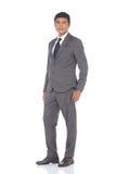 Pełna długości kłapnięcia postać, Biznesowego mężczyzna stojak w szarość Nadaje się spodnia a Zdjęcia Stock