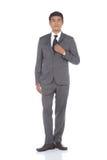 Pełna długości kłapnięcia postać, Biznesowego mężczyzna stojak w szarość Nadaje się spodnia a Zdjęcia Royalty Free