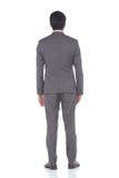 Pełna długości kłapnięcia postać, Biznesowego mężczyzna stojak w szarość Nadaje się spodnia a Fotografia Stock