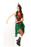 Pełna długości kobieta jest ubranym elfa odzieżowego mienia białego sztandar na podłoga Obrazy Stock