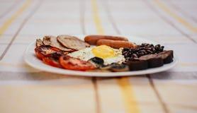 Pełne angielszczyzny smażący śniadanie z bekonem, jajko, kiełbasy, czarny pudding, ono rozrasta się Zdjęcie Royalty Free