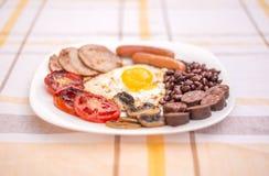 Pełne angielszczyzny smażący śniadanie z bekonem, jajko, kiełbasy, czarny pudding, ono rozrasta się Obrazy Stock