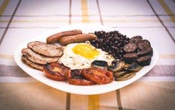 Pełne angielszczyzny smażący śniadanie z bekonem, jajko, kiełbasy, czarny pudding, ono rozrasta się Obrazy Royalty Free
