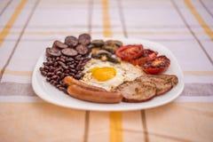 Pełne angielszczyzny smażący śniadanie z bekonem, jajko, kiełbasy, czarny pudding, ono rozrasta się Zdjęcia Royalty Free