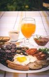 Pełne angielszczyzny smażący śniadanie z bekonem, jajko, kiełbasy, czarny pudding, ono rozrasta się Fotografia Stock