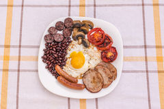 Pełne angielszczyzny smażący śniadanie z bekonem, jajko, kiełbasy, czarny pudding, ono rozrasta się Fotografia Royalty Free