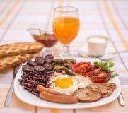 Pełne angielszczyzny smażący śniadanie z bekonem, jajko, kiełbasy, czarny pudding, ono rozrasta się Obraz Stock