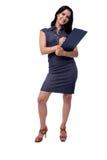 Pełny ciało portret uśmiechnięta biznesowa kobieta w sukni pisze z schowkiem i piórem odosobnionymi, na bielu fotografia stock