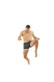 Pełny długość portret boksera wojownik w kopnięcie ruchu Zdjęcia Royalty Free