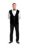 Pełny długość portret rozochocony męski kelner Zdjęcie Royalty Free