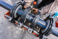 Pe pipe. PE pipe welding for connecting the water pipe in the plant,selective focus Royalty Free Stock Image