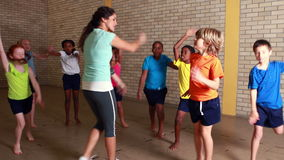 PE teacher with her pupils. At the elementary school stock footage
