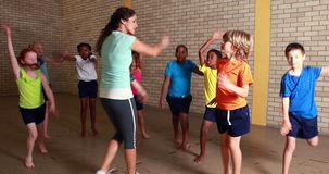 PE teacher with her pupils. At the elementary school stock video