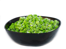 Pea. Frozen peas in black bowl Royalty Free Stock Images