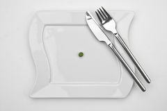 The pea. One pea on a white plate with fork and knife Royalty Free Stock Photos