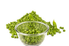 Pea Balls. In glass bowl and their heap on white background Royalty Free Stock Image
