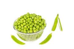 Pea Balls & Pods. Pea balls in glass bowl on white background with null pods Stock Photography