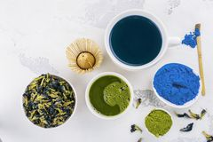 Pea butterflly, green matcha tea. Blue pea butterflly and green matcha tea on white background. Copy space stock photography