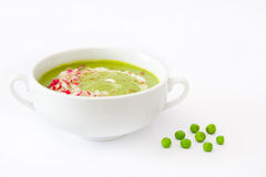 Pea cream with radishes isolated on white background. Homemade pea cream with radishes isolated on white background Stock Image