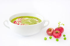 Pea cream with radishes isolated on white background. Homemade pea cream with radishes isolated on white background Stock Photography