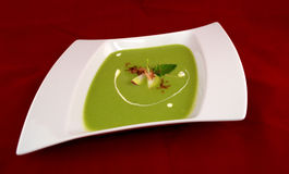 Pea cream soup with apple.  royalty free stock image