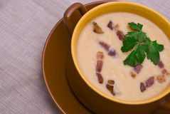 Pea Cream Soup with Grilled Bacon. On Gray Cloth Royalty Free Stock Images