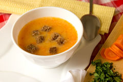 Pea cream soup with pumpkins, carrots and rye croutons Royalty Free Stock Image