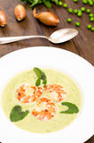 Pea cream soup with shrimps Royalty Free Stock Photo