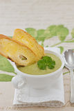 Pea cream soup in white bowl Stock Images