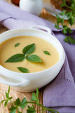 Pea cream soup in a white tureen Royalty Free Stock Images