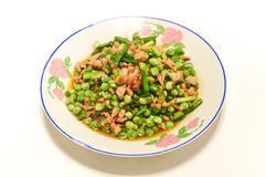 Pea dish. Add garlic, peas and pork frying some of the ingredients mixed dishes Stock Photos