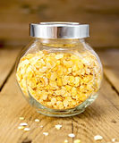 Pea flakes in jar on board Royalty Free Stock Image